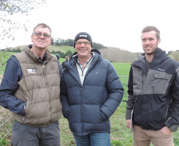 Neil Sanderson (left) talks to Angus New Zealand president John Cochrane (centre) and his son,...