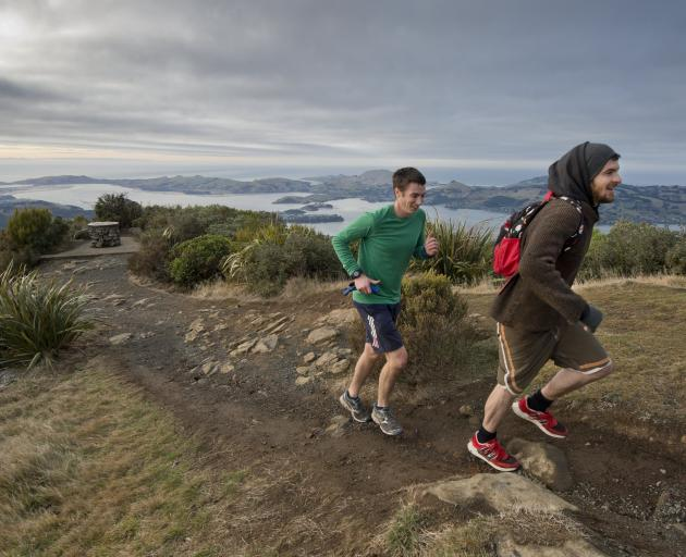 Brothers Rory and Callum McLean reach the summit of Mt Cargill during the Crush the Cargill event...