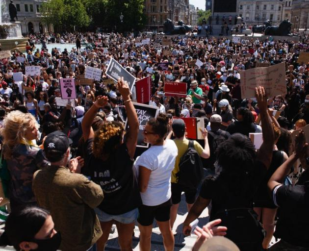 Protesters gather in London in solidarity with those in the United States over the death of...