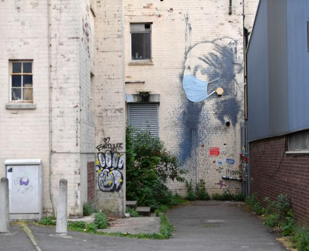 Graffiti artwork by Banksy named 'Girl with a Pierced Eardrum' at Hannover Place in Bristol,...
