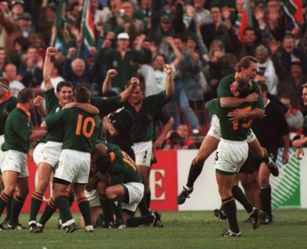 The Springboks celebrate winning the Rugby World Cup exactly 25 years ago. PHOTO: GETTY IMAGES