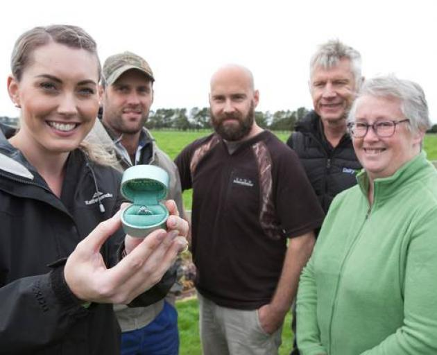 Rachel (left), Chris, Blake, DairyNZ farm performance head of lower North Island Rob Brazendale and Jeanette show off the diamond ring. Photo / Supplied