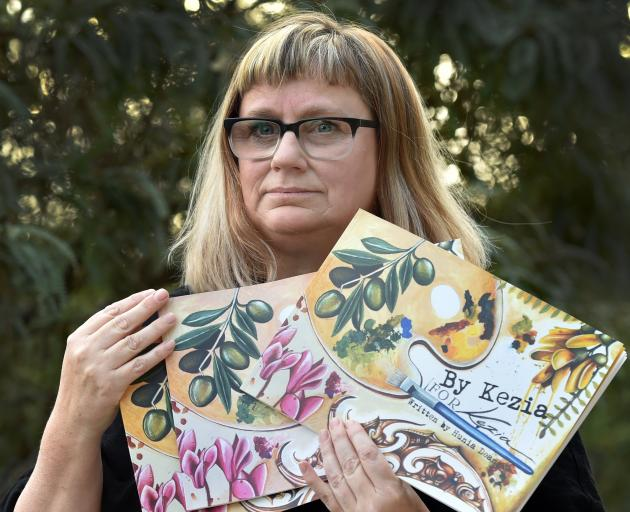 Dunedin woman Kezia Field has illustrated a book in memory of husband Hunia Dean, who died in...