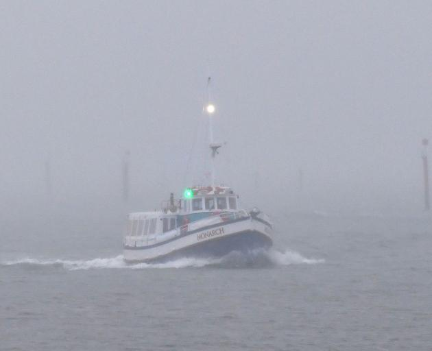 Monarch heads back into the harbour basin through a mist of drizzle late yesterday afternoon....