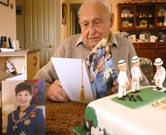 Lionel Woods reads a card from The Queen wishing him a happy 100th birthday, ...