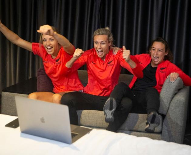 Football Ferns Erin Walker, Hannah Wilkinson and Annalie Longo celebrate New Zealand winning the...