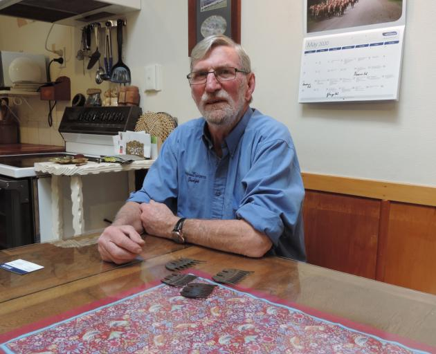 Colin Gibson, at his North Otago farmhouse table with shearing combs from New Zealand, Australia, and the United States, has been a shearing judge for 50 years. PHOTO: SALLY BROOKER