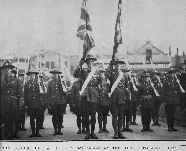 The colours of two of the battalions of the Otago Regiment are conveyed under escort to First...