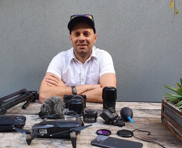 Tom Woodward with the cameras and attachments he used to capture the ...