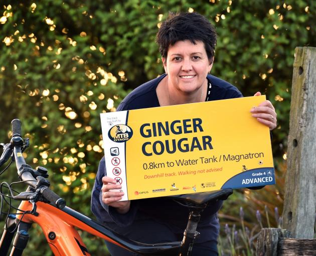 Mountain Biking Otago president Kristy Booth says goodbye to one of the signs deemed '...