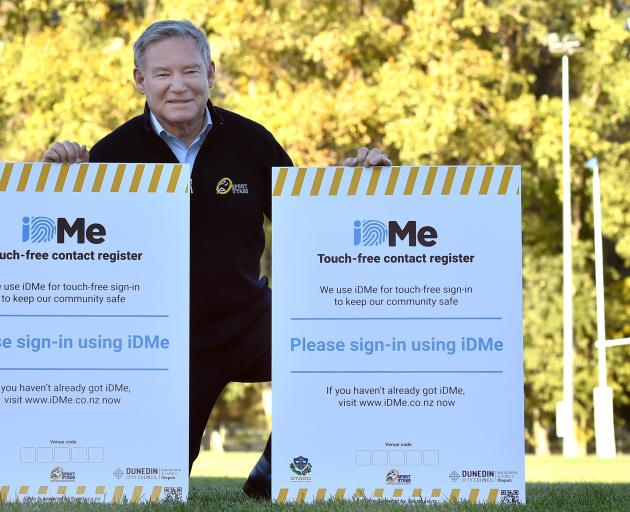 Sign of the times . . . Sport Otago chief executive John Brimble with the contact tracing signs...