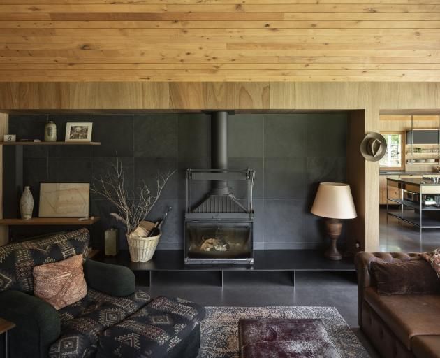 The cosy living area has a Philippe Chemise fireplace and no television. ''We can just [allow]...