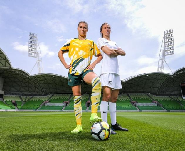 Stephanie Catley of Australia and Rebekah Stott of New Zealand pose for photos during the...