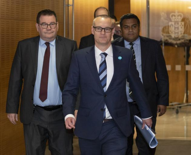 Dunedin North MP David Clark, flanked by colleagues Grant Robertson and Kris Faafoi, arrives at a...