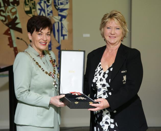 Governor-General Dame Patsy Reddy with Karen Corlett receiving the insignia for athletics great...