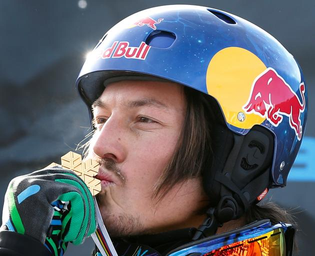 Alex Pullin kisses his medal after the men's snowboard-cross finals in Quebec in 2013. Photo:...