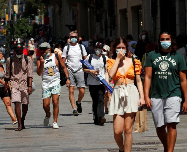 People wearing protective face masks out in public in Barcelona, Spain. Photo: Reuters