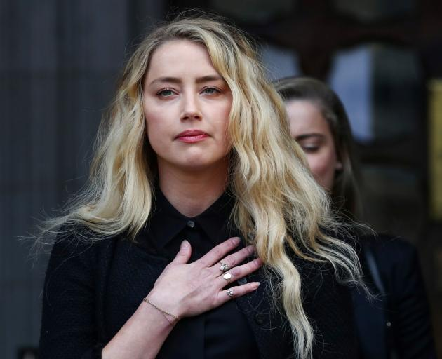 Amber Heard speaks to reporters outside court on Tuesday. Photo: Reuters