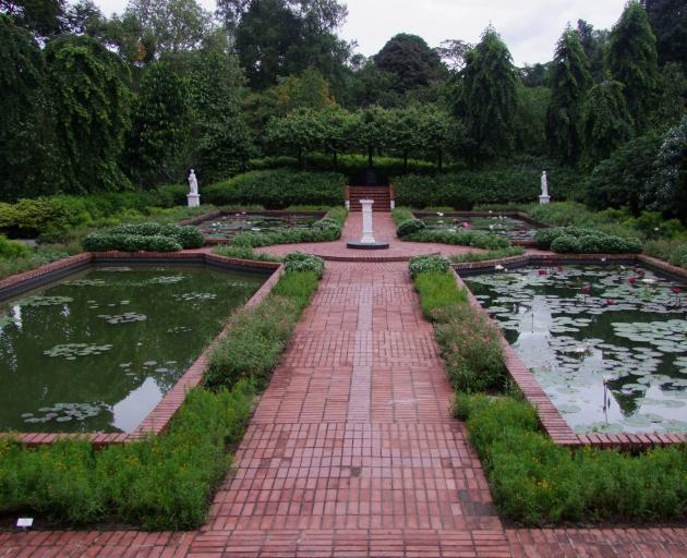 The lily pond in the Singapore Botanic Gardens looks like a tropical clone of an English garden...