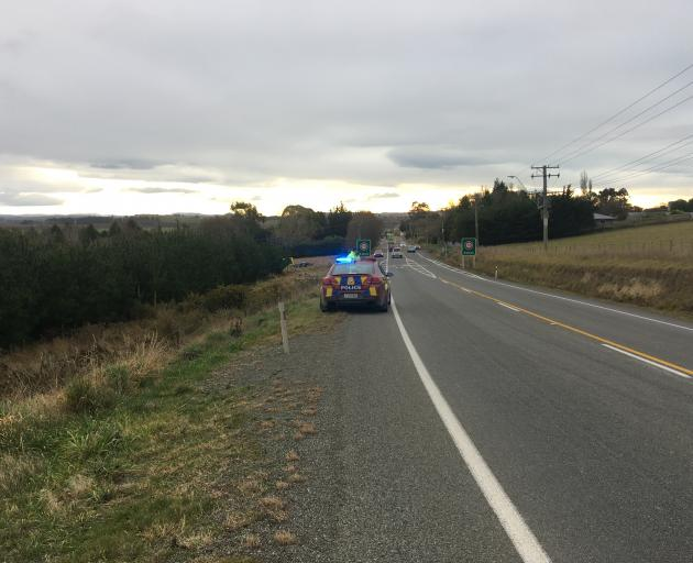 A police car near the scene where a car left the road just south of Maheno. Photo: Gus Patterson