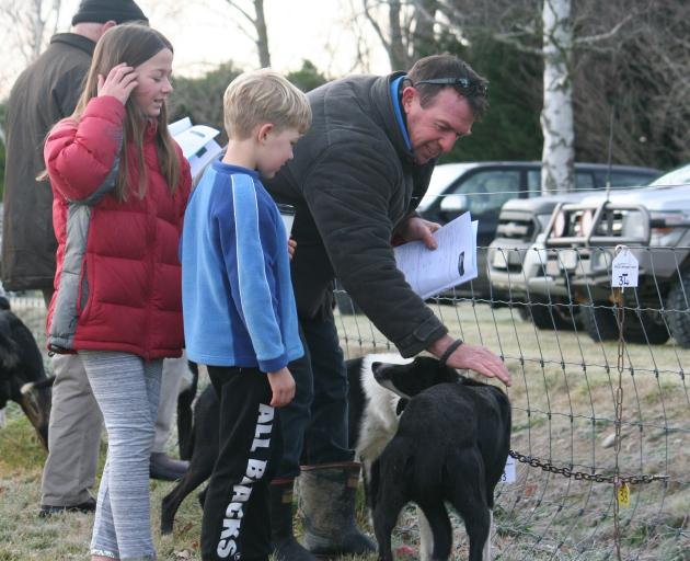 Stuart Barnes, from North Otago, with children Eva (11) and Max (8) on the lookout for any deals...