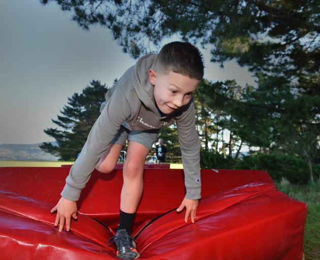 Hugo Beeby (9), of Dunedin, tackles the crash-pad obstacle in a cross-country event at Rotary...