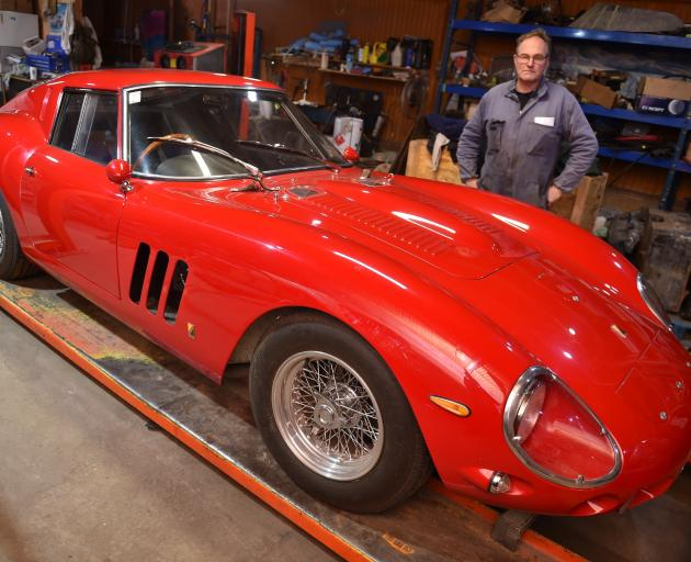Rod Tempero stands proudly beside one of the GT-style racing cars from the 1960s built in his...