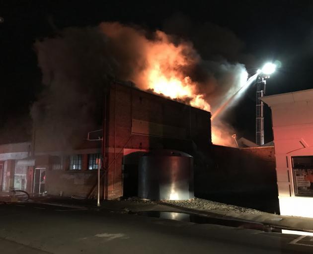 Fire engulfs a building on Rankeilor St in South Dunedin. Photo: Gregor Richardson
