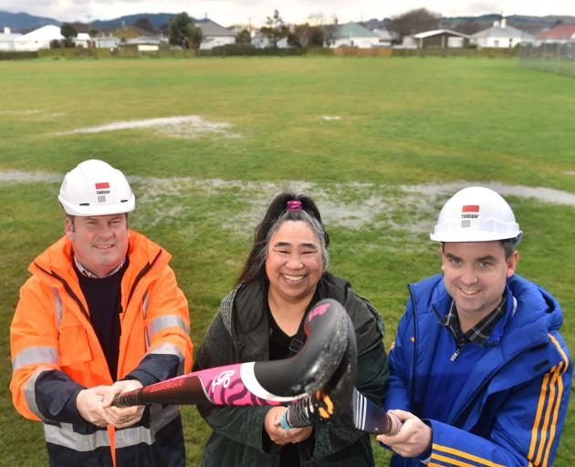 Looking forward to the construction of the hockey turf at King's High School are (from left) King...