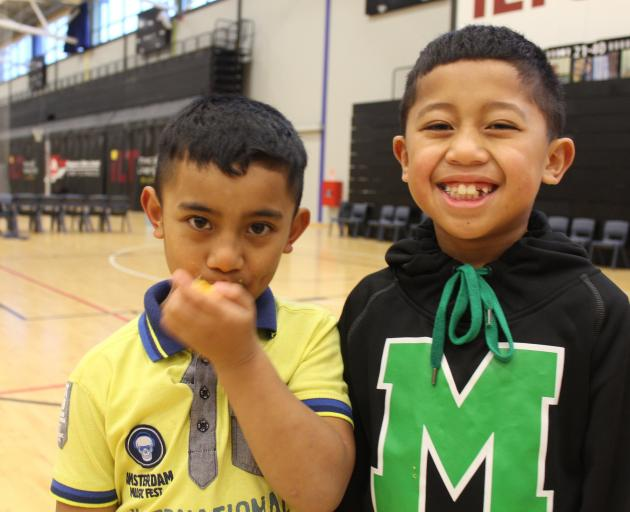 Invercargill children Taoa Fiso  (7, left) and Ene Molioo (8) at the Pasifika Youth Sports Day at...