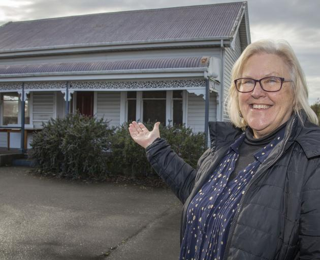 Reverend Phyllis Harris in front of the Lincoln Union Church's old manse building that is being...