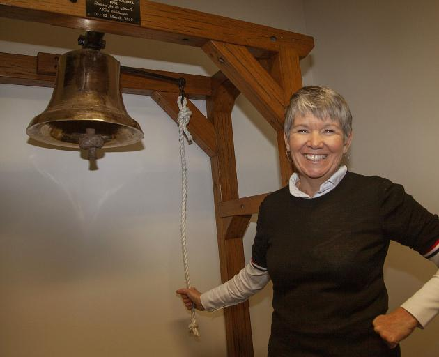 Bernadette May with the school's restored bell from 1931. Photo: Geoff Sloan