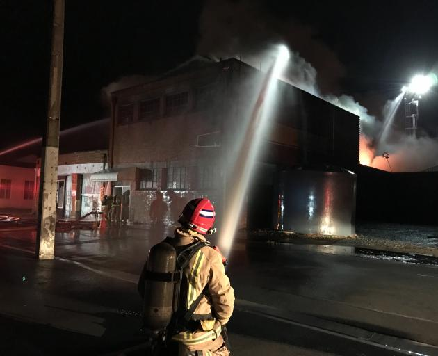 Firefighters battle a large fire on Rankeilor St in South Dunedin. Photo: Gregor Richardson