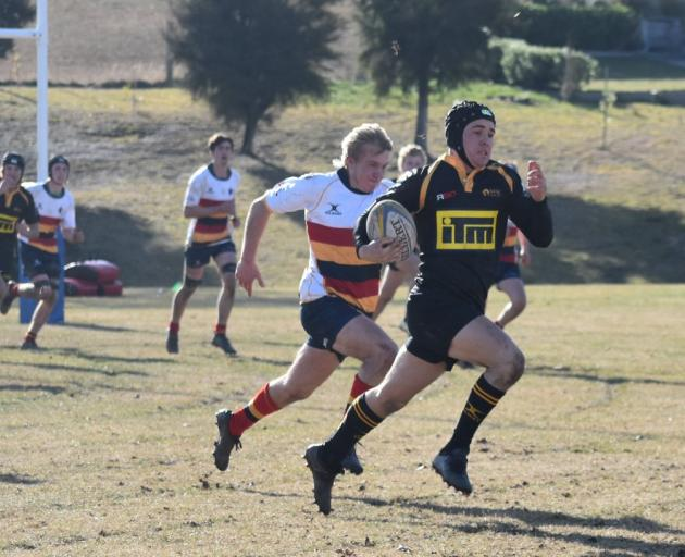 Kamryn Reddy of Mt Aspiring College on his way to the try line after intercepting a pass against...