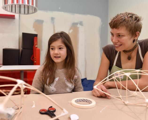 Charlotte Reddington (6), of Mosgiel, and volunteer Mimi Schroeder take part in a lantern-making...