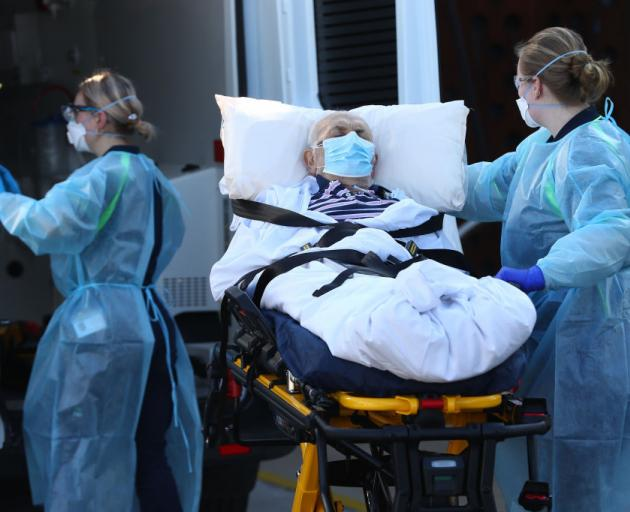 A  aged care resident is relocated in Melbourne yesterday. Photo: Getty Images