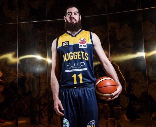 Nuggets player Jordan Ngatai models the new Nuggets uniform. When they return tomorrow night...