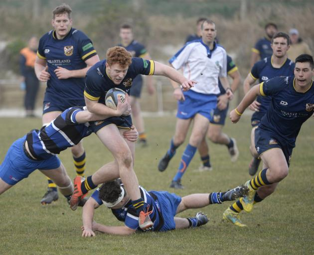 Dunedin first five-eighth Harrison Boyle evades one tackle but gets caught in another during a...