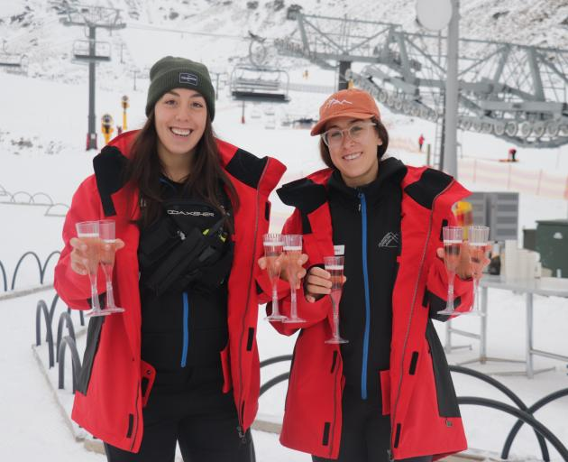 Remarkables staff Kendra Stronach and Alex Laframboise enjoy a drink in celebration of the resorts opening for 2020. Photo: Hugh Collins