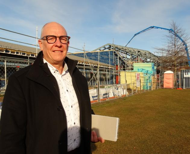 Arrowtown School principal Chris Bryant inspects progress on the rebuilding project. PHOTO: GUY...