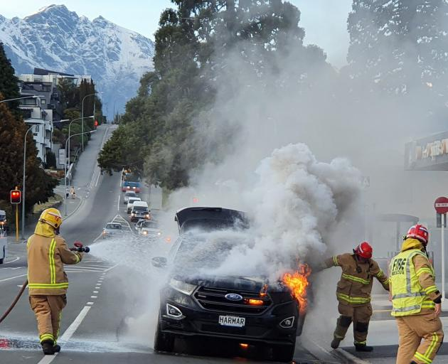 A couple from Mosgiel managed to get out of their car before it burst into flames in Stanley St,...