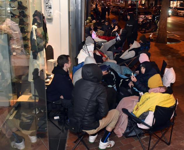 Dozens camped out in George St on Thursday night to buy a pair of the shoes.