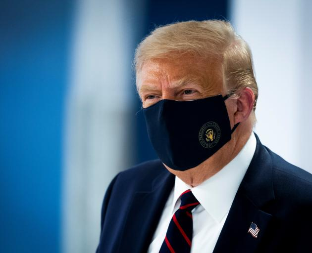 US President Donald Trump wears a protective face mask. Photo: Reuters