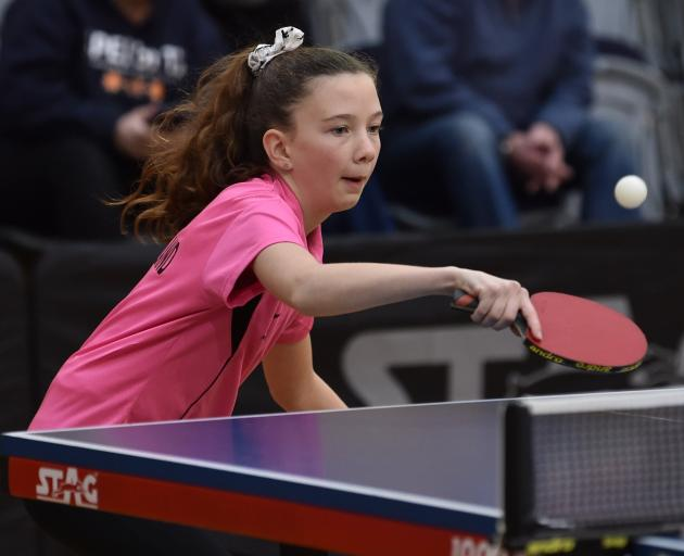 Southland's Zoe Gray (12) hits the ball during an under-13 doubles final