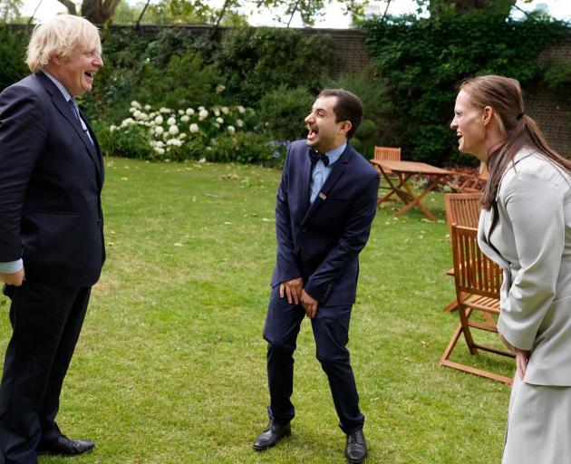 Boris Johnson shares a joke with nurses Luis Pitarma and Jenny McGee. Photo: Boris Johnson/ Twitter