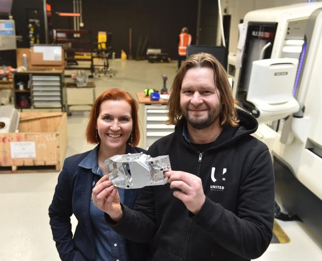 Sarah and Alex Ramsay show off a CNC-milled component in their new factory room at United...