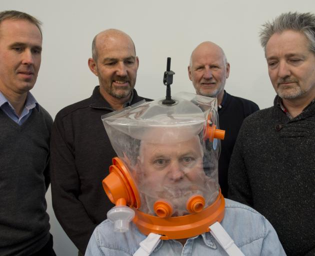 Mark Seaton, Chris Hopkins, William Early and Andrew Wallace look on as Richard Aimers tries on a...