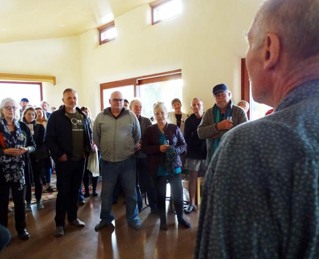 Maori Point Vineyard owner John Harris (right) calls to order the meeting of more than 50 locals...