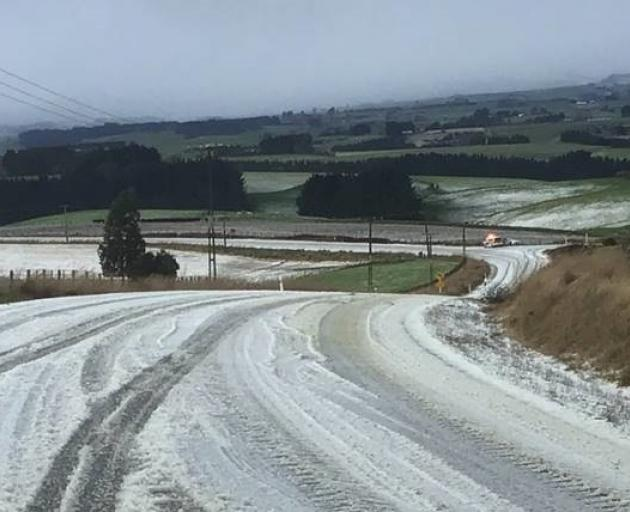 Snow on the road in Wyndham-Letterbox Road this morning. Photo: Southland District Council