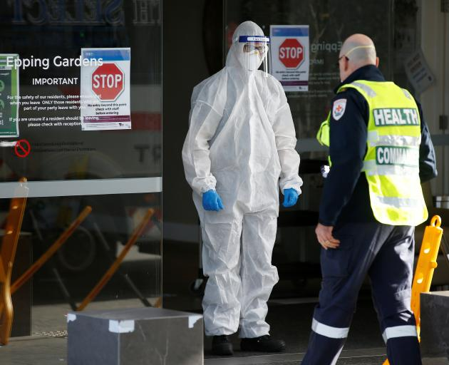 Medical staff and a health commander at an aged care facility experiencing an outbreak of Covid...